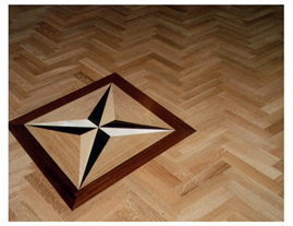 New parquet flooring, Woodford. Oak parquet wood floor with feature star inset..