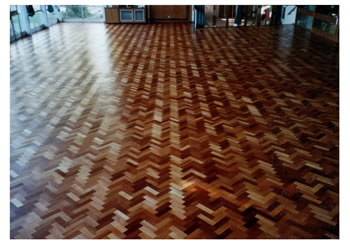 Wood floor sanding in Presdales School, Hertfordshire. Herringbone floorboard sanding in Hertfordshire..