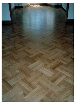 New parquet wood flooring, Hendon, London. Oak parquet wooden floor in a basket weave pattern with a small dot..