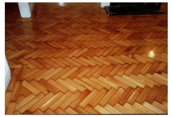 Reclaimed wood floors, installed and finished in Saffron Walden. Reclaimed pine wood block flooring in herringbone pattern, cleaned, installed, sanded and sealed..