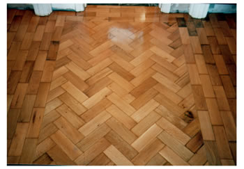 Reclaimed wood floors, installed and finished in Belsize Park, London. Reclaimed wooden blocks from County Hall, installed in herringbone pattern, sanded and sealed..