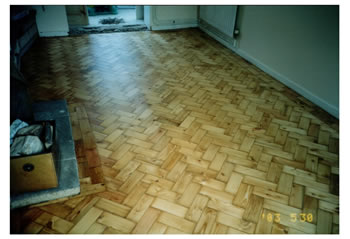 Wood floor stripping and repairs in Much Hadham. We made repairs to this pine wood block flooring in a herringbone pattern..