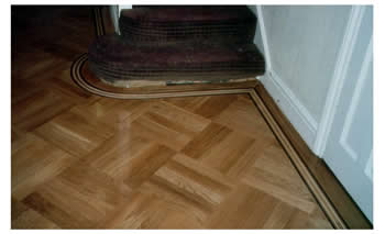 New parquet flooring in Potters Bar, Herts. Parquet wood floor laid in basket weave pattern with curved border..