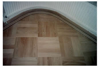 New parquet wood floor installation in Potters Bar. Parquet wooden flooring in basket weave pattern with a curved border..