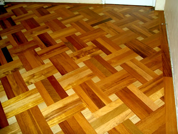New parquet wood flooring in Stamford Hill. Merbau parquet wood floor in basket weave pattern with small oak dot..
