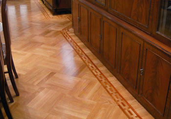 Oak wood floor in basket weave pattern. We installed this new flat sawn european oak in a basket weave pattern with a hand-made mahogany chain border..