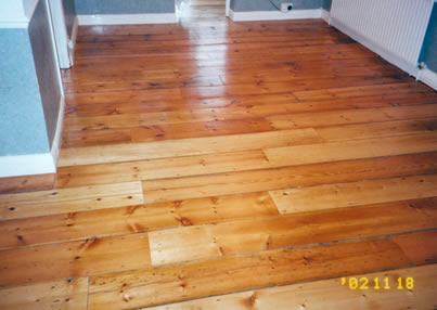 Reclaimed pine floor boards in Islington. We stripped and sanded this existing pine wood flooring..