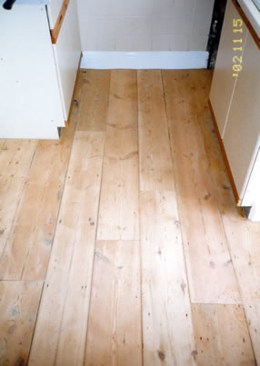 Pine floor board stripping in Harlow, Essex. We stripped and sanded these existing pine floorboards..